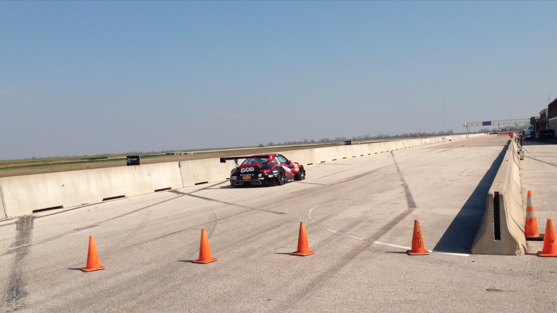 car blowing by us on the straightaway