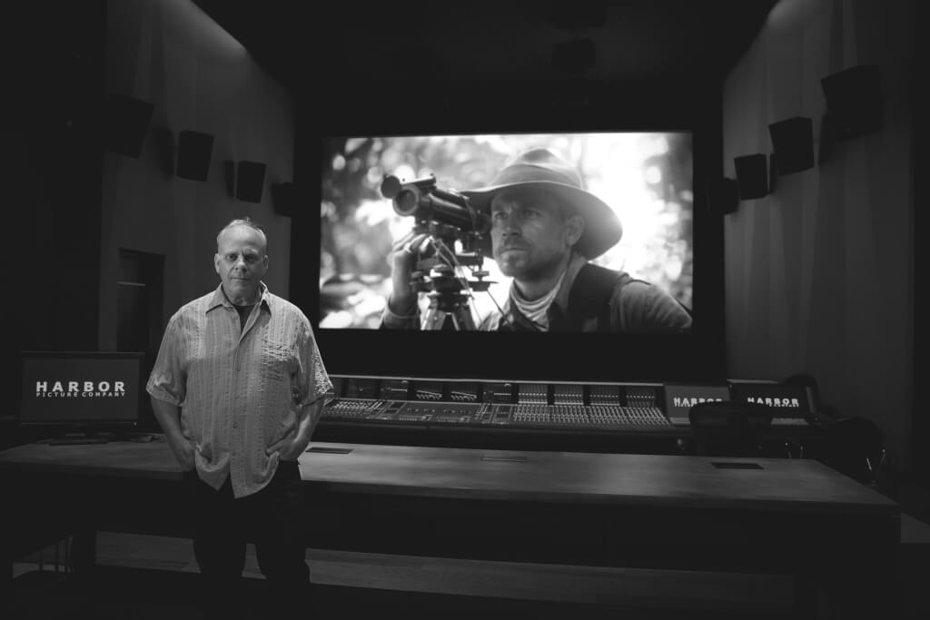 Bob Hein in the mix room at Harbor Post with a still from the film The Lost City of Z.